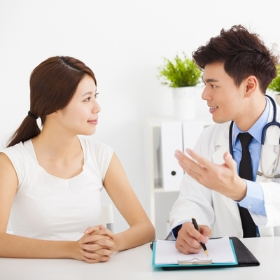 Reviewing Health Check up Results with Doctor
